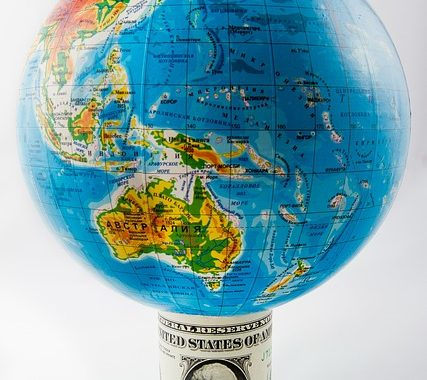 image of the world globe on a dollar bill